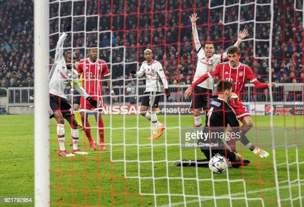 Thomas Mueller of FC Bayern Muenchen scores his team's first goal against goalkeeper Fabri of Besiktas Istanbul during the UEFA Champions League...