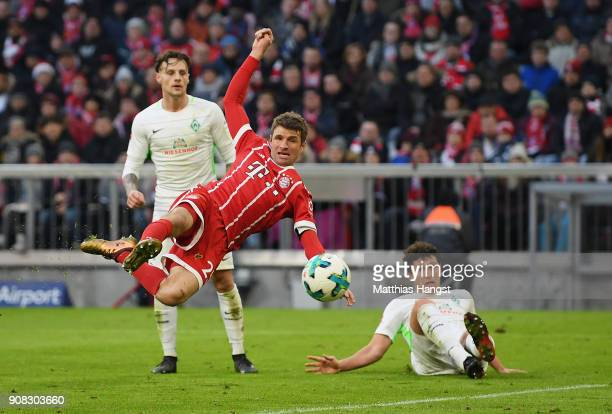 Thomas Mueller of FC Bayern Muenchen scores his team's first goal during the Bundesliga match between FC Bayern Muenchen and SV Werder Bremen at...