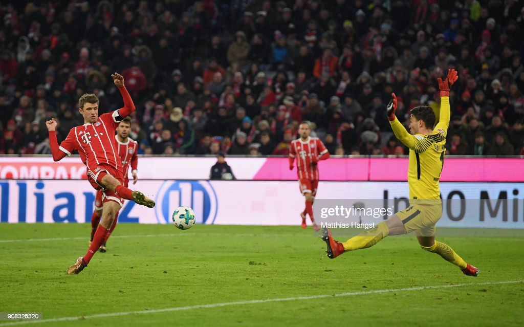 Thomas Mueller of FC Bayern Muenchen scores his team's fourth goal past Goalkeeper Jiri Pavlenka of Bremen during the Bundesliga match between FC Bayern Muenchen and SV Werder Bremen at Allianz Arena on January 21, 2018 in Munich, Germany.