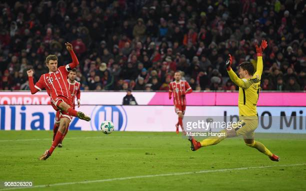 Thomas Mueller of FC Bayern Muenchen scores his team's fourth goal past Goalkeeper Jiri Pavlenka of Bremen during the Bundesliga match between FC...
