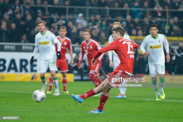Thomas Mueller of FC Bayern Muenchen scores his team's second goal from the penalty spot during the Bundesliga match between Borussia...
