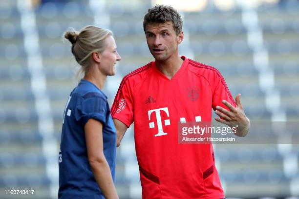 Thomas Mueller of FC Bayern Muenchen talks to Team manager Kathleen Krueger during a training session at Children`s Mercy Park during the eight day...