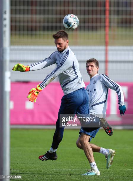 Thomas Mueller of FC Bayern Muenchen tries to score against goalkeeper Sven Ulreich of FC Bayern Muenchen during a training session at Saebener...