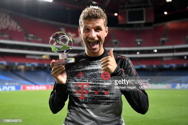 Thomas Mueller of FC Bayern Munich poses for a photo with his UEFA Champions League Man of the Match award following the UEFA Champions League...