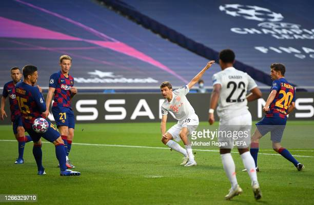 Thomas Mueller of FC Bayern Munich scores his team's first goal during the UEFA Champions League Quarter Final match between Barcelona and Bayern...