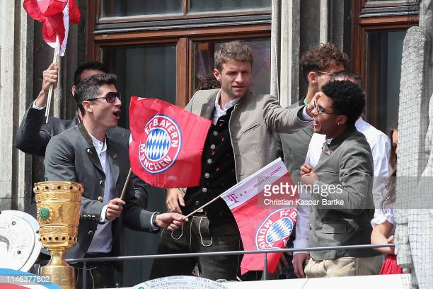 Thomas Mueller of FC Mueller reacts reacts during an event to celebrate FC Bayern Muenchen winning the Bundesliga and the German Cup at Marienplatz...