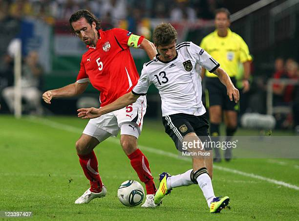 Thomas Mueller of Germany and Christian Fuchs of Austria battle for the ball during the UEFA EURO 2012 qualifying match between Germany and Austria...