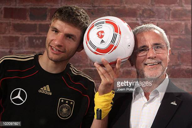 """Thomas Mueller of Germany and former german football player Gerd Mueller are pictured with the first official ball, """"Torfabrik"""" for the german..."""