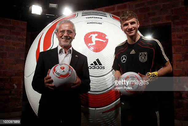 Thomas Mueller of Germany and former german football player Gerd Mueller are pictured with the first official ball 'Torfabrik' for the german...