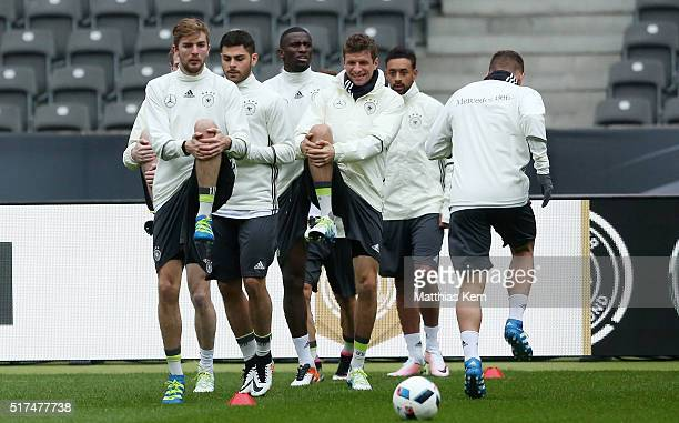 Thomas Mueller of Germany and his team mates warm up during a Germany training session ahead of a international friendly match against England at...