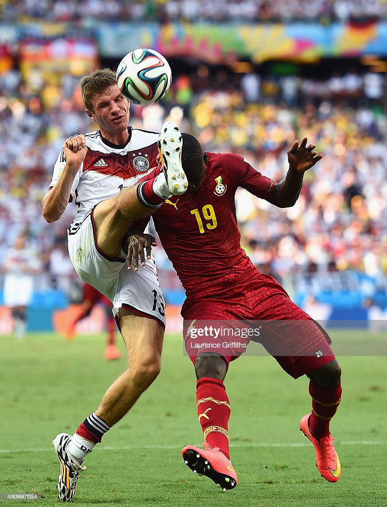 Thomas Mueller of Germany and Jonathan Mensah of Ghana compete for the ball during the 2014 FIFA World Cup Brazil Group G match between Germany and Ghana at Castelao on June 21, 2014 in Fortaleza, Brazil.