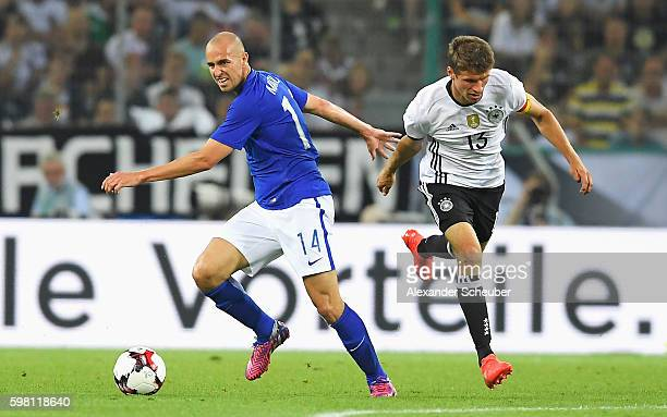 Thomas Mueller of Germany and Sakari Mattila of Finland in action during the International Friendly match between Germany and Finland at BorussiaPark...