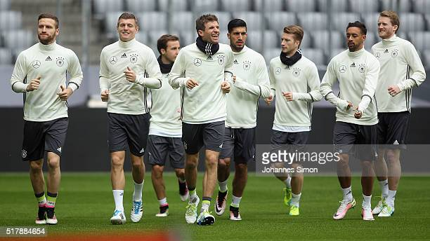 Thomas Mueller of Germany and team mates participate in the training session ahead of the international friendly match between Germany and Italy at...