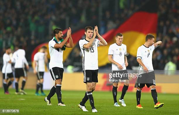 Thomas Mueller of Germany and the Germany squad celebrate victory during the FIFA 2018 World Cup Qualifier between Germany and Northern Ireland at...