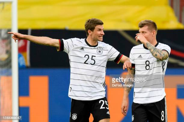 Thomas Mueller of Germany and Toni Kroos of Germany gesture during the international friendly match between Germany and Latvia at Merkur Spiel-Arena...
