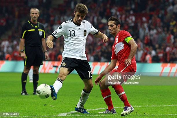 Thomas Mueller of Germany battles for the ball with Hamit Altintop of Turkey during the UEFA EURO 2012 Group A qualifying match between Turkey and...
