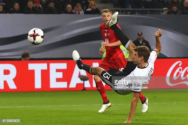 Thomas Mueller of Germany battles for the ball with Ladislav Krejci of Czech Republic during the 2018 FIFA World Cup Qualifier match between Germany...