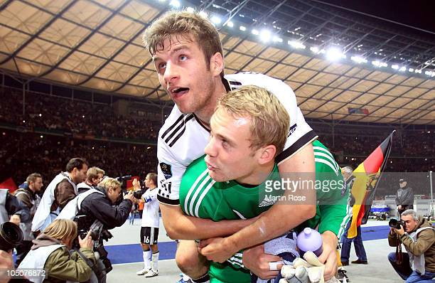 Thomas Mueller of Germany celebrate with team mate Manuel Neuer after winning the EURO 2012 Group A qualifier match between Germany and Turkey at...