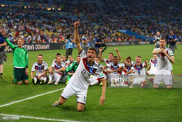 Thomas Mueller of Germany celebrate with teammates after defeating Argentina 10 in extra time during the 2014 FIFA World Cup Brazil Final match...