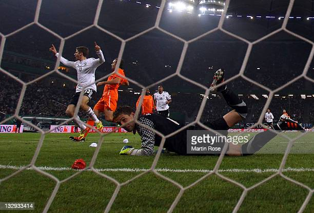Thomas Mueller of Germany celebrates after he scores his team's opening goal during the International friendly match between Germany and Netherlands...
