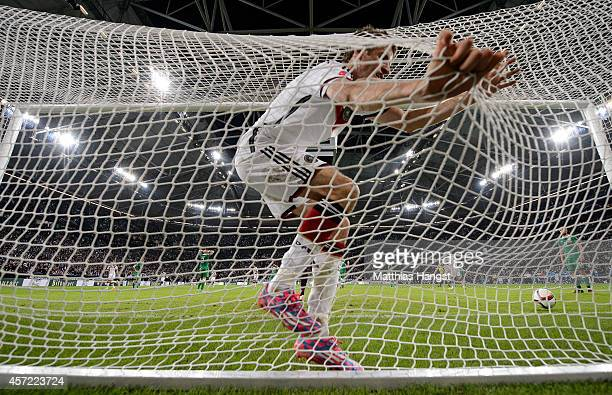 Thomas Mueller of Germany celebrates after his teams first goal during the EURO 2016 Group D qualifying match between Germany and Ireland at Veltins...