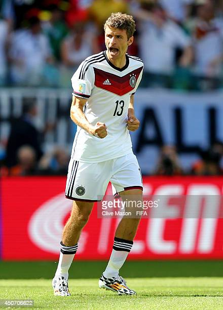 Thomas Mueller of Germany celebrates after scoring a goal from the penalty spot during the 2014 FIFA World Cup Brazil Group G match between Germany...
