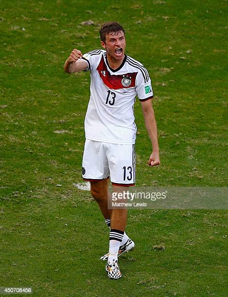 Thomas Mueller of Germany celebrates after scoring his team's third goal during the 2014 FIFA World Cup Brazil Group G match between Germany and...