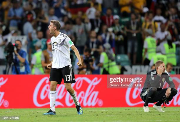 Thomas Mueller of Germany celebrates at final whistle as Robin Olsen of Sweden kneels down deejcted following the 2018 FIFA World Cup Russia group F...