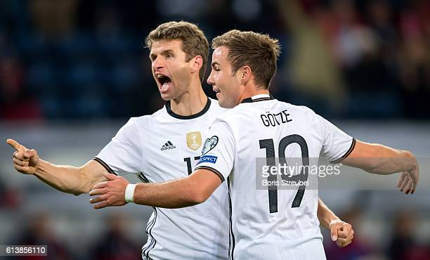 Thomas Mueller of Germany celebrates his team's first goal with Mario Goetze during the FIFA World Cup 2018 qualifying match between Germany and...