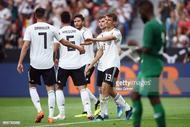 Thomas Mueller of Germany celebrates his team's second goal with team mates during the international friendly match between Germany and Saudi Arabia...