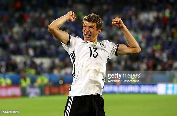 Thomas Mueller of Germany celebrates his team's win through the penalty shootout during the UEFA EURO 2016 quarter final match between Germany and...