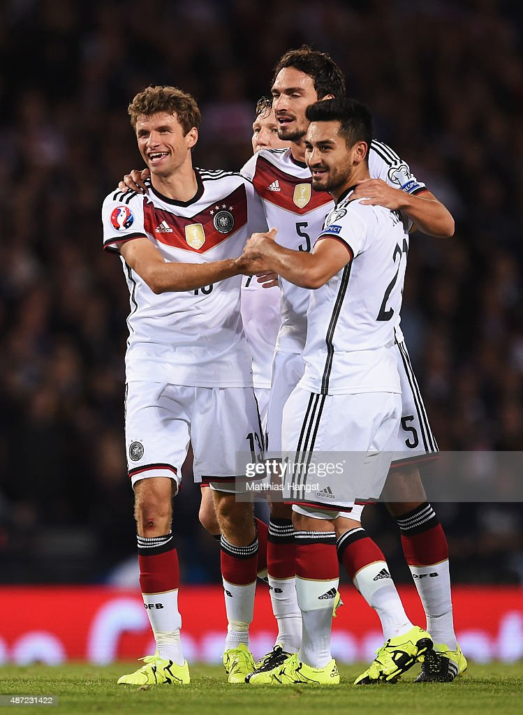 Thomas Mueller (L) of Germany celebrates scoring Germany's second goal with team mates during the UEFA EURO 2016 Qualifier Group D match between Scotland and Germany at Hampden Park on September 7, 2015 in Glasgow, Scotland.