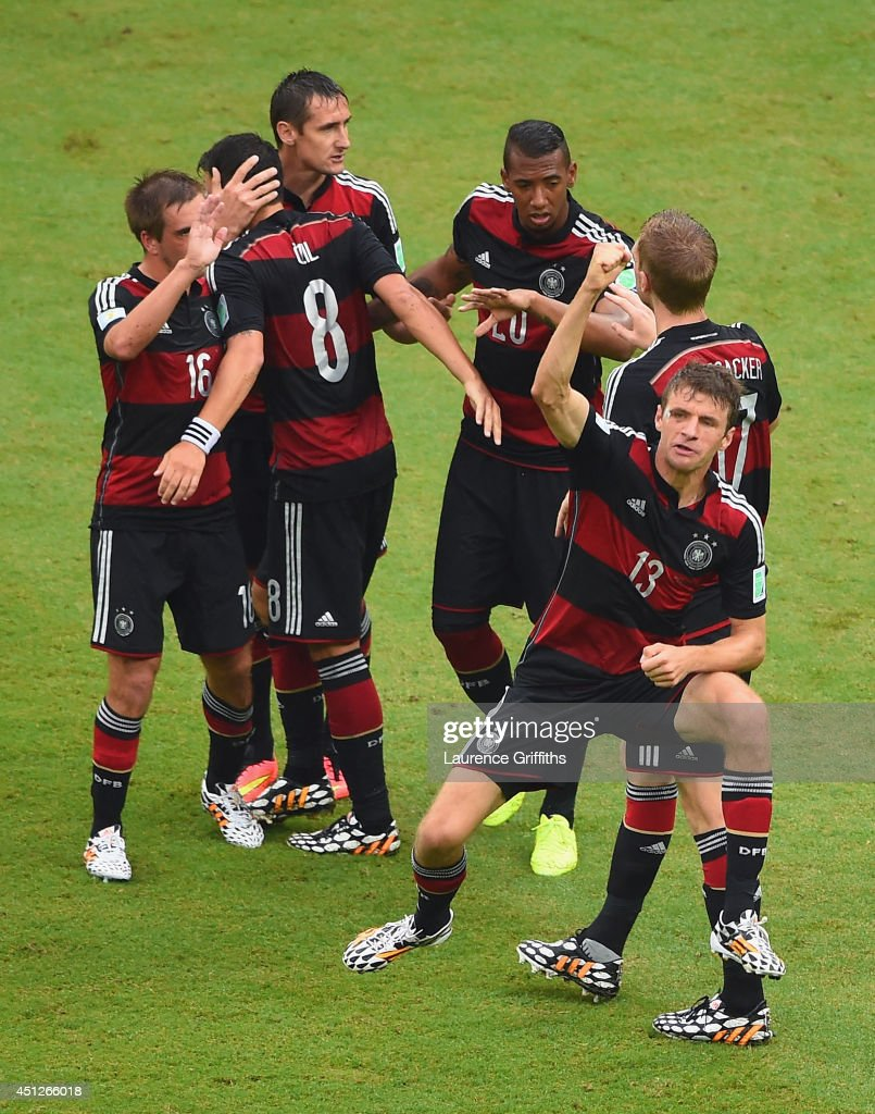 Thomas Mueller of Germany (R) celebrates scoring his team's first goal with teammates during the 2014 FIFA World Cup Brazil group G match between the United States and Germany at Arena Pernambuco on June 26, 2014 in Recife, Brazil.