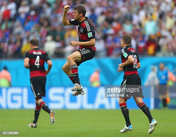 Thomas Mueller of Germany celebrates scoring his team's first goal during the 2014 FIFA World Cup Brazil group G match between the United States and...