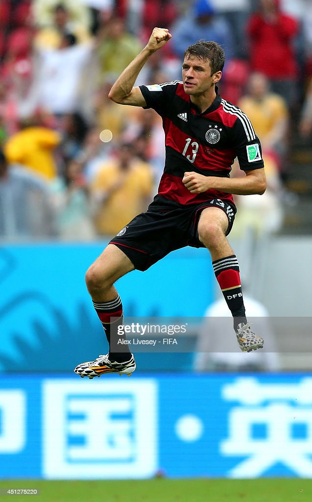Thomas Mueller of Germany celebrates scoring his team's first goal during the 2014 FIFA World Cup Brazil Group G match between USA and Germany at Arena Pernambuco on June 26, 2014 in Recife, Brazil.