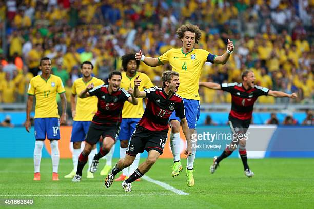 Thomas Mueller of Germany celebrates scoring his team's first goal during the 2014 FIFA World Cup Brazil Semi Final match between Brazil and Germany...