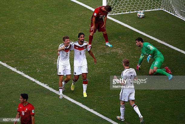 Thomas Mueller of Germany celebrates scoring his team's fourth goal and completing his hat trick with Sami Khedira and Andre Schuerrle as Joao...