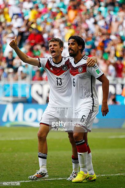 Thomas Mueller of Germany celebrates scoring his team's fourth goal and completing his hat trick with Sami Khedira during the 2014 FIFA World Cup...