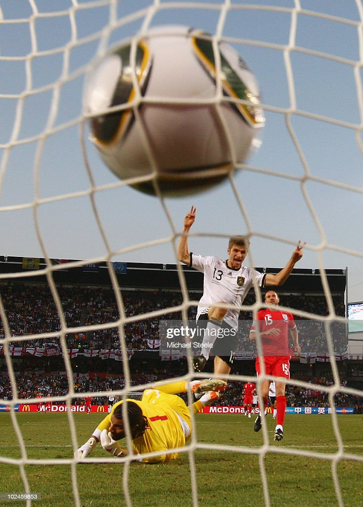 Thomas Mueller of Germany celebrates scoring his teams fourth past goal David James of England during the 2010 FIFA World Cup South Africa Round of Sixteen match between Germany and England at Free State Stadium on June 27, 2010 in Bloemfontein, South Africa.
