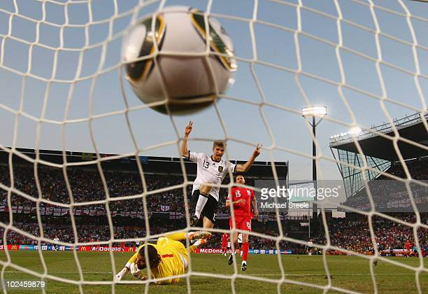 Thomas Mueller of Germany celebrates scoring his teams fourth past goal David James of England during the 2010 FIFA World Cup South Africa Round of...