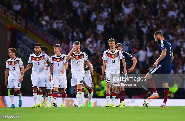 Thomas Mueller of Germany celebrates scoring his teams opening goal with team mate Toni Kroos during the UEFA EURO 2016 Qualifier Group D match...