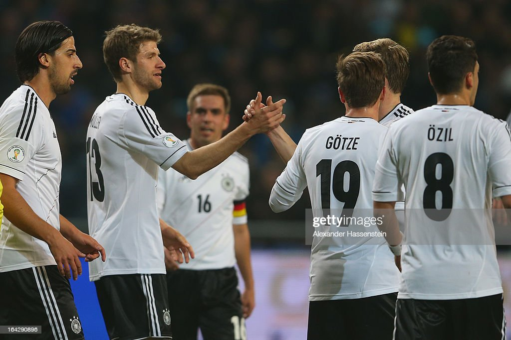 Thomas Mueller (2nd L) of Germany celebrates scoring the 2nd team goal with his team mates during the FIFA 2014 World Cup qualifier group C match between Kazakhstan and Germany at Astana Arena on March 22, 2013 in Astana, Kazakhstan.
