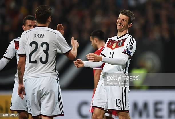 Thomas Mueller of Germany celebrates scoring the opening goal during the EURO 2016 Group D Qualifier match between Germany and Gibraltar at Grundig...