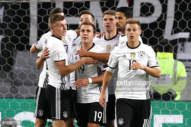 Thomas Mueller of Germany celebrates scoring the opening goal with his team mates during the 2018 FIFA World Cup Qualifier match between Germany and...