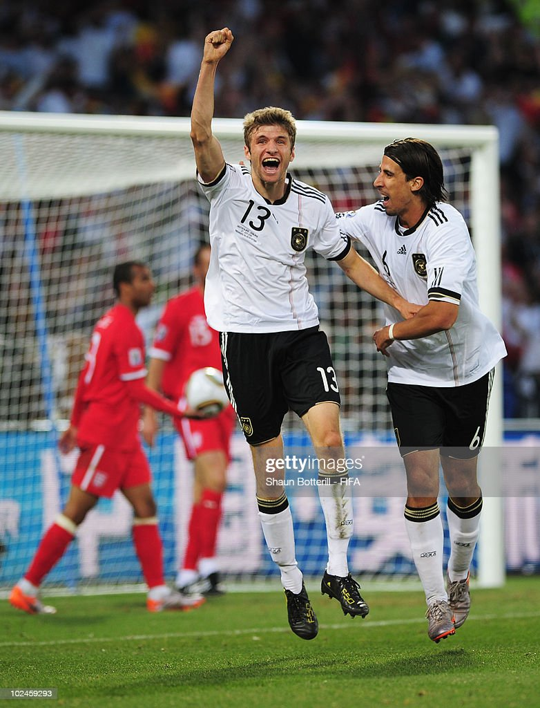 Thomas Mueller of Germany celebrates scoring their fourth goal with teammate Sami Khedira during the 2010 FIFA World Cup South Africa Round of Sixteen match between Germany and England at Free State Stadium on June 27, 2010 in Bloemfontein, South Africa.