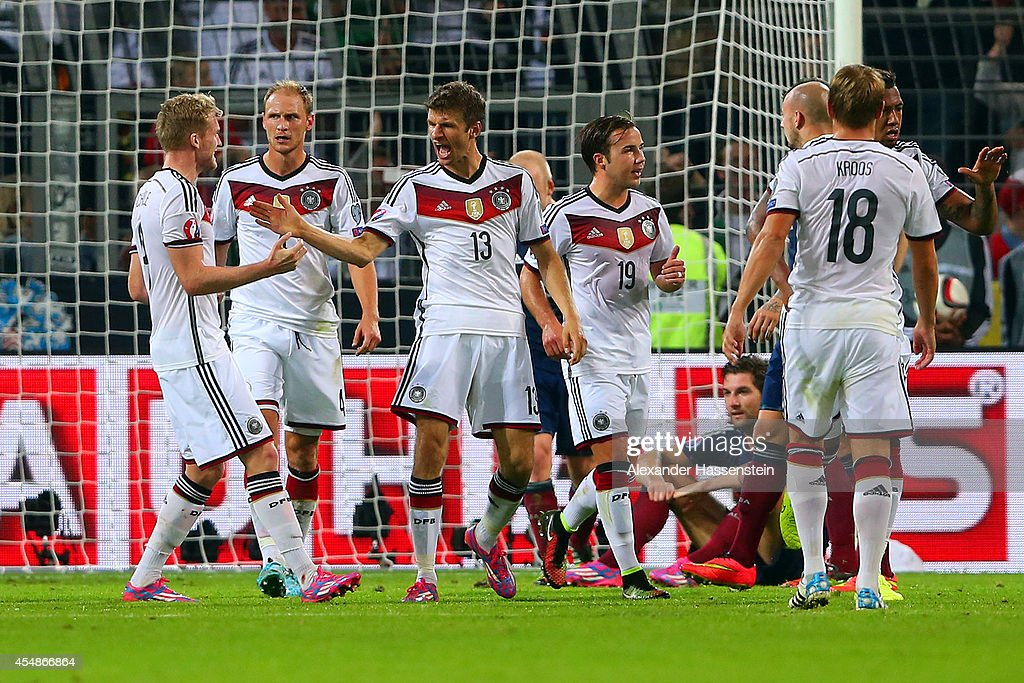 Thomas Mueller of Germany (13) celebrates scoring their second goal with team mates during the EURO 2016 Group D qualifying match between Germany and Scotland at Signal Iduna Park on September 7, 2014 in Dortmund, Germany.