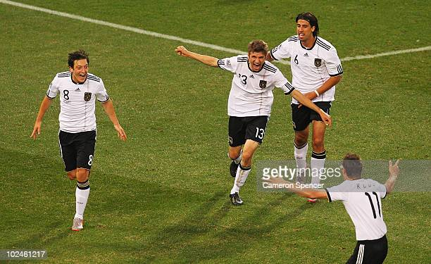 Thomas Mueller of Germany celebrates scoring with team mates Mesut Oezil Sami Khedira and Miroslav Klose during the 2010 FIFA World Cup South Africa...