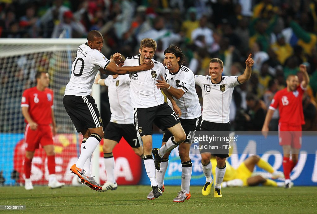 Thomas Mueller of Germany (C) celebrates scoring with teammates during the 2010 FIFA World Cup South Africa Round of Sixteen match between Germany and England at Free State Stadium on June 27, 2010 in Bloemfontein, South Africa.