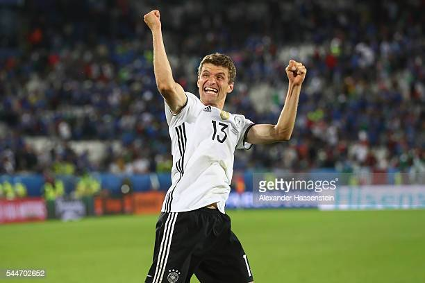 Thomas Mueller of Germany celebrates victory after winning the UEFA EURO 2016 quarter final match between Germany and Italy at Stade Matmut...