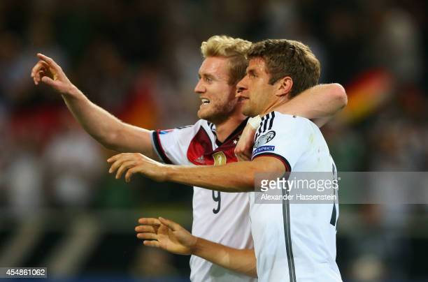 Thomas Mueller of Germany celebrates with Andre Schuerrle as he scores their first goal with a header during the EURO 2016 Group D qualifying match...